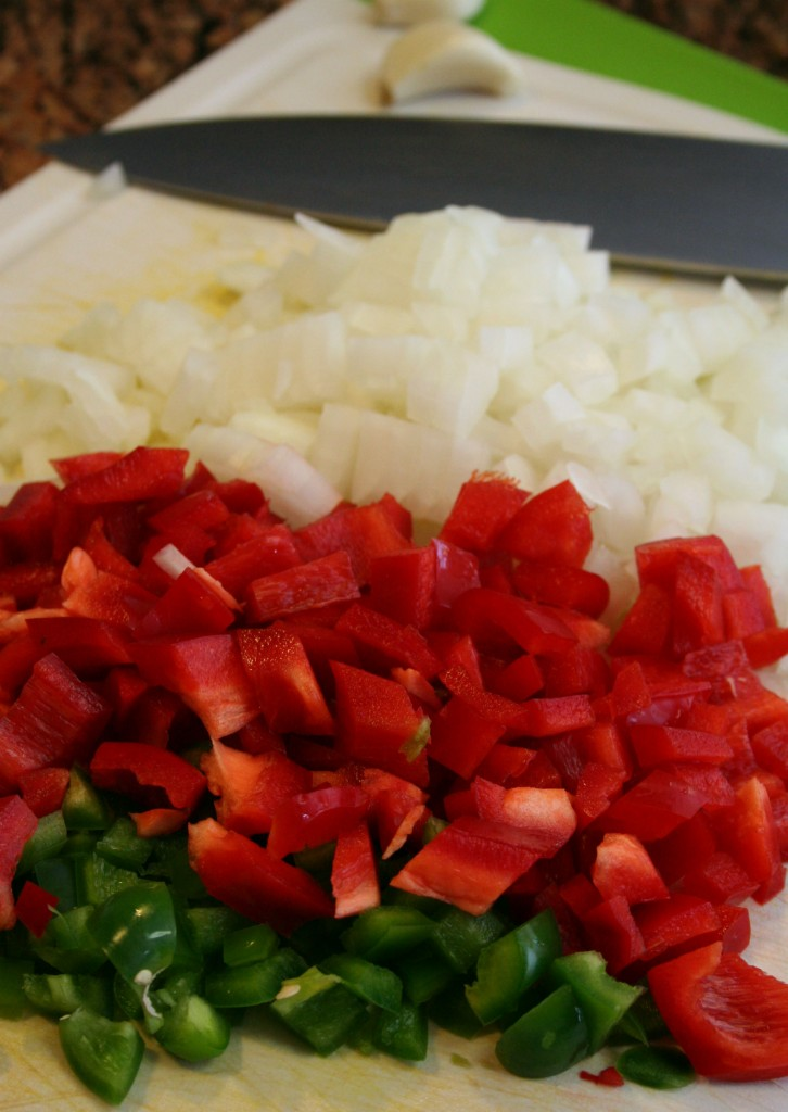 Add the onion, red bell pepper and jalapeno to the pan.